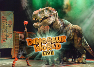 Tyrannosaurus Rex on Stage with green spotlights in the background.