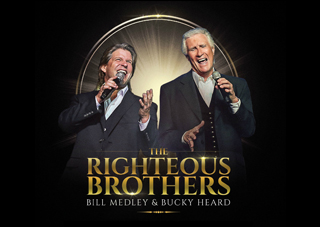 Image of the Righteous Brothers standing with microphones with their text logo below them.