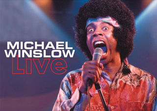 Classic photo of Michael Winslow doing standup with his microphone